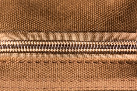 Photo for Brown texture with closed zipper - Royalty Free Image