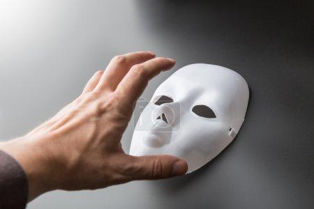Human hand  take mask