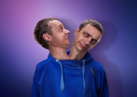 Photo for Concept of split personality, a man with two heads over blue background - Royalty Free Image