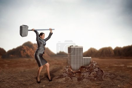 Angry Businesswoman with sledgehammer
