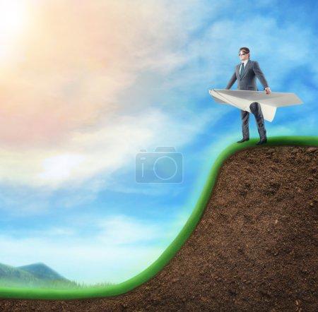 Businessman in paper plane