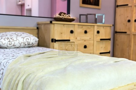 Photo for Modern bedroom interior with wooden furniture - Royalty Free Image