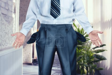 Businessman pulling out empty pockets