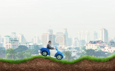 businessman driving toy car