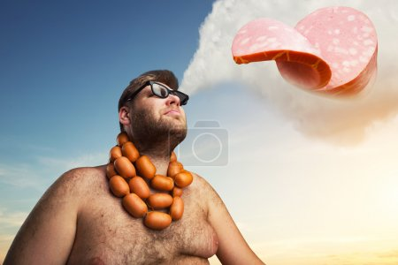 Fat man with sausages