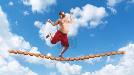 Fat Man running on sausage rope