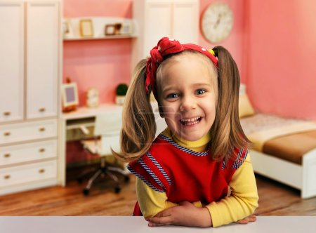 Photo for Cute little girl smiling in room - Royalty Free Image
