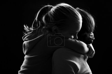 Little girl hugging her mother