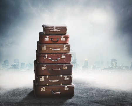 Stack of old brown suitcases