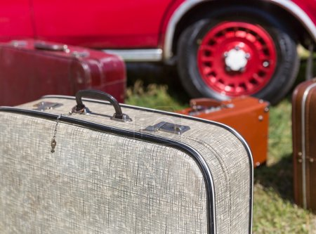 suitcases over  retro car