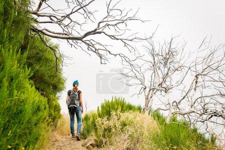 female Traveler hiking in mountains