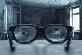 Broken eyeglasses with cracks