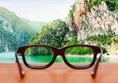 Eyeglasses on the table over mountain