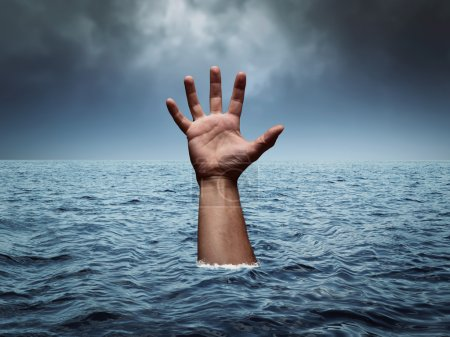 Drowning hand in stormy sea asking for help...