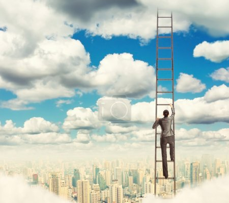 Businesswoman climbing on ladder