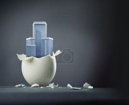 broken egg with building