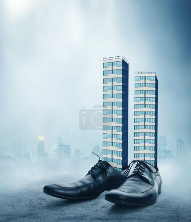Office buildings in male shoes