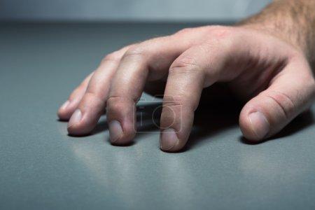 Human hand on table