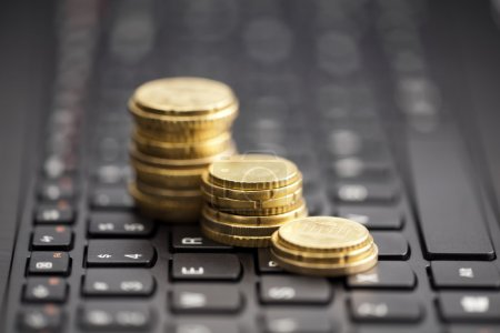 Rising coins on keyboard