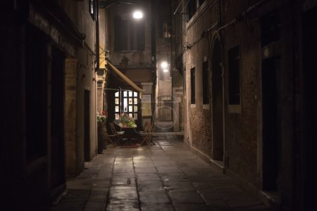 Cozy restaurant in an alley at night in Venice