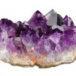 Mineral amethyst crystals on a white background...
