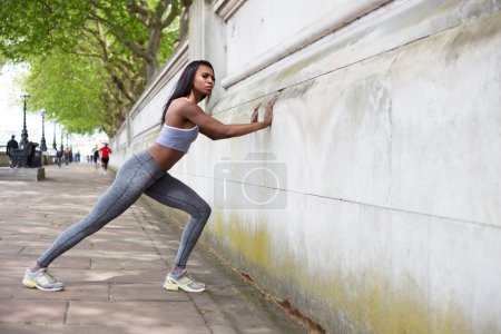 fitness woman stretching in the park