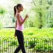 Fitness woman walking in the park...