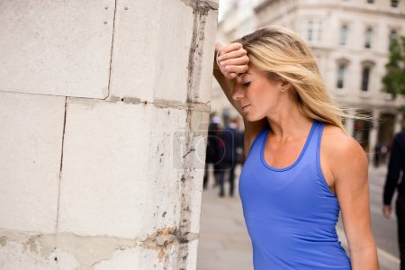 Young woman out of breath from running
