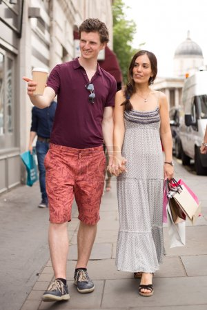 young couple walking in the street