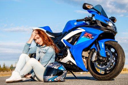 Pretty young woman and Suzuki