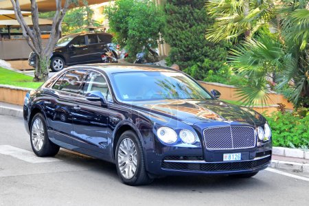 Photo for MONTE CARLO, MONACO - AUGUST 2, 2014: British luxury car Bentley Continental Flying Spur at the city street near the casino. - Royalty Free Image