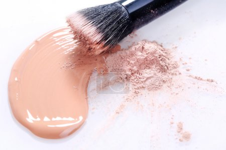 Smeared Liquid Beige Make Up Foundation on White Background