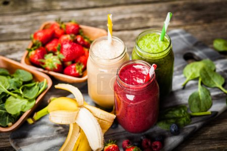 Photo for Assortment of milkshakes and smoothies on wooden table - Royalty Free Image