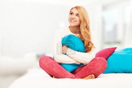 Photo for Young blond woman relaxing in bed - Royalty Free Image