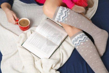 Photo for Female legs in warm woolen socks. - Royalty Free Image