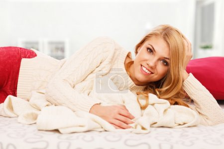 Photo for Young woman relaxing in bed - Royalty Free Image