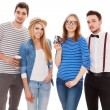 Four stylish young people on white background....