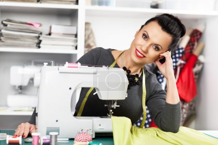 Young woman at a sewing machine