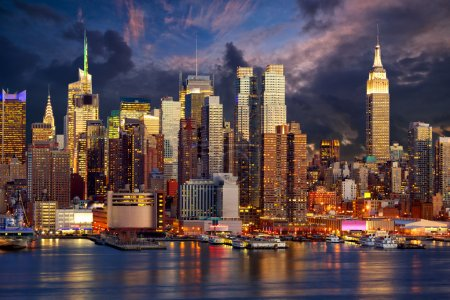 Photo for Manhattan Midtown skyline at twilight over Hudson River, New York City - Royalty Free Image