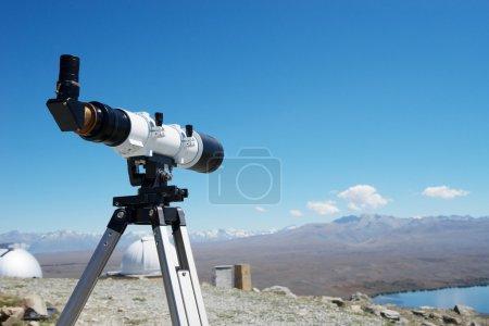 camera on ground near lake