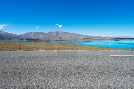 Asphalt road near lake in New Zealand