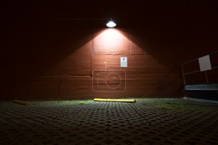 brick floor and wall with a light at night