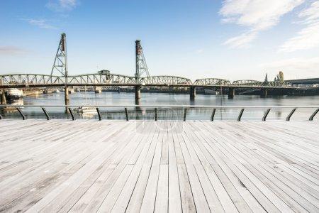 Photo for Empty wood floor with steel bridge over sea in Portland - Royalty Free Image
