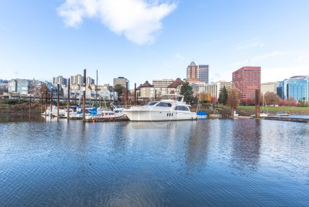 yachts on water with cityscape and skyline in Portland