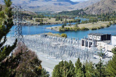 power substation on the side of river and mountains
