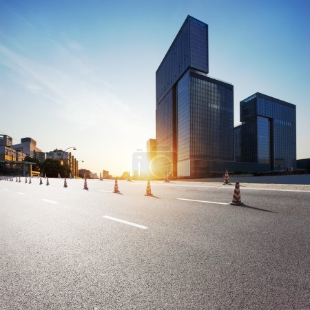 Photo for Urban road in modern city at sunrise - Royalty Free Image