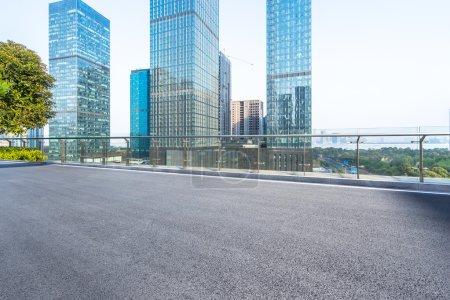 asphalt road near modern office buildings