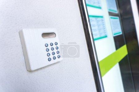 Modern hi-tech door key on wall
