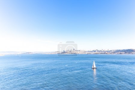 sail boat on sea with cityscape of San Francisco