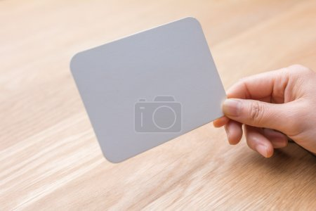 Photo for Woman's hand holding white blank paper - Royalty Free Image